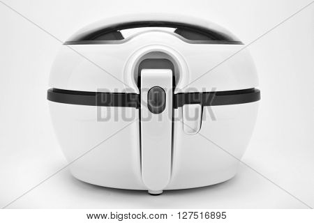 closeup of a white multicooker on a white background