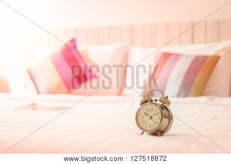close up view of alarm clock in morning bedroom environment.