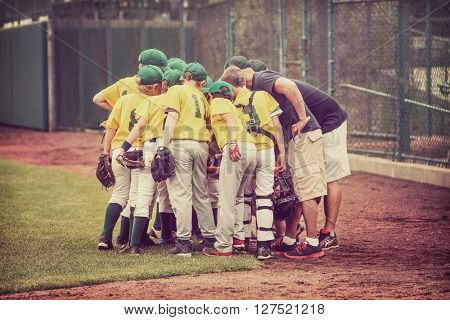 Baseball team in a huddle vintage toned