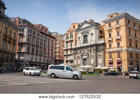 Naples Italy - August 9 2015: Street view of old Naples. Piazza Trieste E Trento facade of Galleria Umberto
