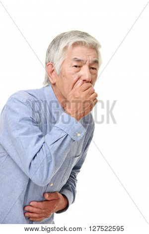 senior Japanese man feels like vomiting  on white background