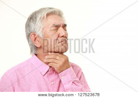 studio shot of senior Japanese man having throat pain on white background