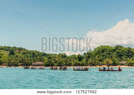 Ampasipohy Nosy Be Madagascar - December 19 2015: Caravan Malagasy traditional outrigger canoes with tourists arrived in Lokobe Strict Reserve in the village of the Ampasipohy Nosy Be Island Madagascar.