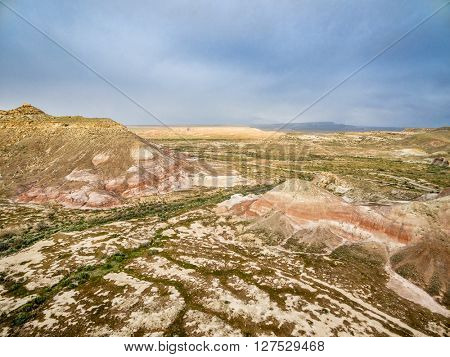 aerial view of badlands with colorful hills near Cisco, Utah, USA