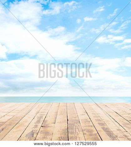 Wooden pier, exotic sea and a blue sky. Beautiful summer background. Vacation and traveling concept.