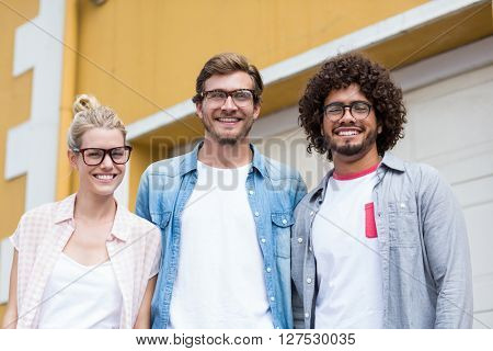 Portrait of happy friends in spectacles