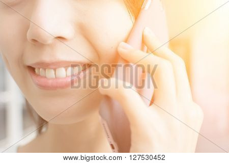 Asian woman talk to cellphone