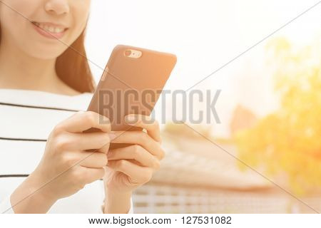 Asian Woman use of cellphone