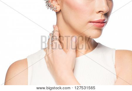 glamour, beauty, jewelry and luxury concept - close up of beautiful woman with golden ring and diamond earring
