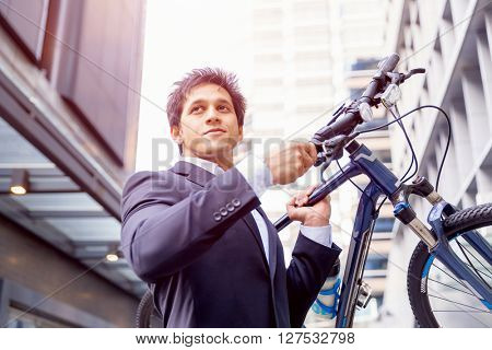 Successful businessman with bicycle