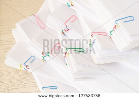 Colorful Paper Clip With Stack Of Overload Paperwork