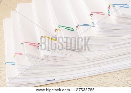Colorful Paper Clip With Step Stack Of Overload Paper