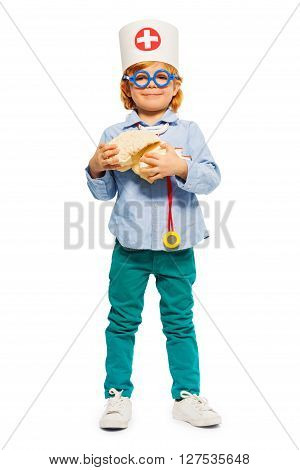 Young 5 years old boy playing a doctor in toy glasses, holding cerebrum dummy, isolated on white
