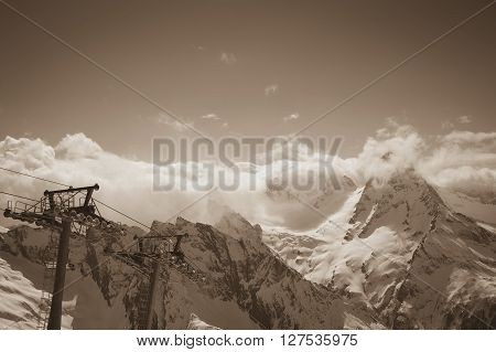 Sepia mountains and ski lift. Caucasus Mountains region Dombay.