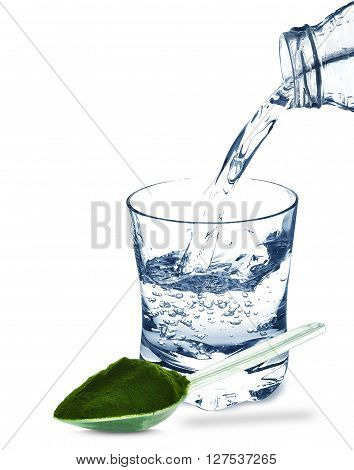 wheat grass and water in a glass isolated on a white background