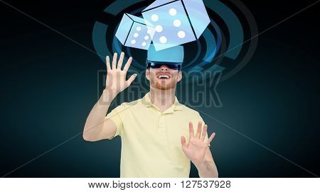 3d technology, virtual reality, cyberspace, entertainment and people concept - happy young man with virtual reality headset or 3d glasses playing game with casino dice projection over black background