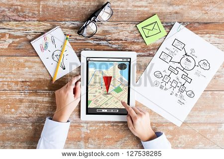 business, people and technology concept - close up of female hands pointing finger to tablet pc computer with gps navigator map on screen, scheme and eyeglasses