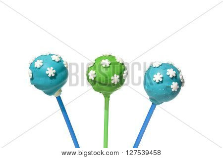 Three tasty colored cakepops on isolated background
