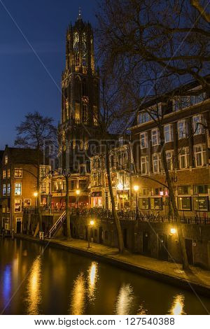Utrecht, The Netherlands - March 14, 2015: Utrecht at night Donkere Gaard Gaardbrug Dom Houses canal and restaurants.