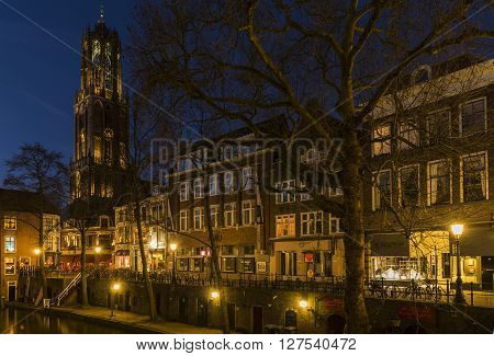 Utrecht, The Netherlands - March 14, 2015: Utrecht at night Donkere Gaard Gaardbrug Dom Church Houses canal and restaurants.