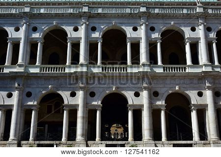 Detail from Basilica Palladiana loggia with round arches columns and architrave knows as