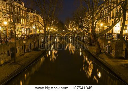 Utrecht, The Netherlands - March 14, 2015: Utrecht at night Oude Gracht bridge houses canal and restaurants.