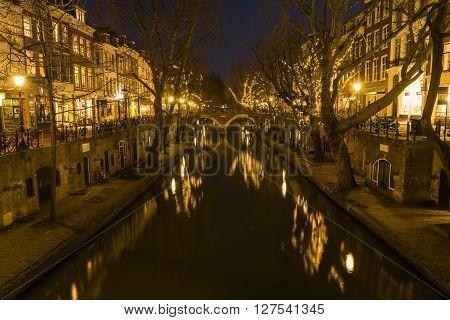 Utrecht, The Netherlands - March 14, 2015: Utrecht at night Oude Gracht bridge houses canal and restaurants.