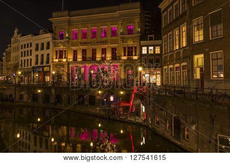 Utrecht, The Netherlands - March 14, 2015: Utrecht at night Oude Gracht Winkel van Sinkel canal and restaurants.