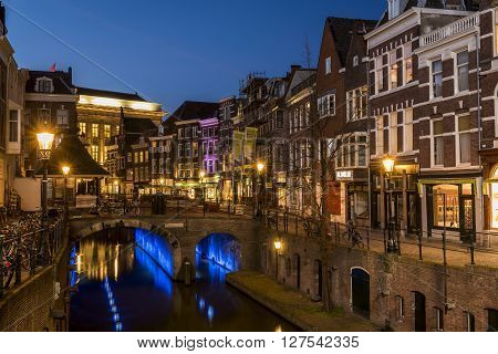 Utrecht, The Netherlands - March 14, 2015: Utrecht at night Vismarkt Houses canal and restaurants.