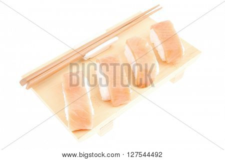 Japanese traditional Cuisine - Set of Nigiri sushi topped with raw Salmon . Isolated over white background