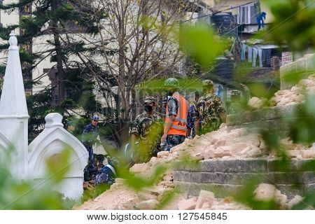 KATHMANDU, NEPAL - APRIL 26, 2015: Nepal Armed Police Force, army, police and civilians start rescue efforts at the collapsed Dharahara tower after the magnitude 7.8 earthquake on 25 April 2015.