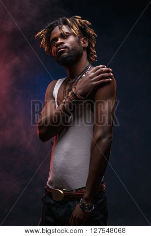 African-american guy in vest against smoky background