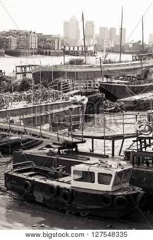 London UK - May 4th 2015: boats piled in the shallow waters of the River Thames in London. Processed in B&W.