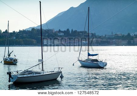 boats floating on the glittery waters of Lake Como in Italy