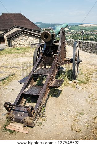 Rusty historic cannon in Trencin castle Slovak republic. Weapons theme. Historical military theme.