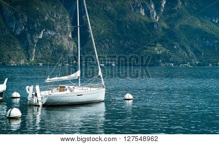 Bellagio, Italy - September 2nd 2015: photo of a white boat floating on Lake Como near the town of Bellagio Lombardy Italy.