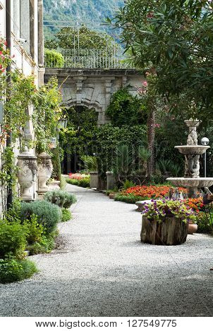 Varenna, Italy - September 4th 2015: a path leading into the botanical garden at Villa Monastero in Varenna Italy.