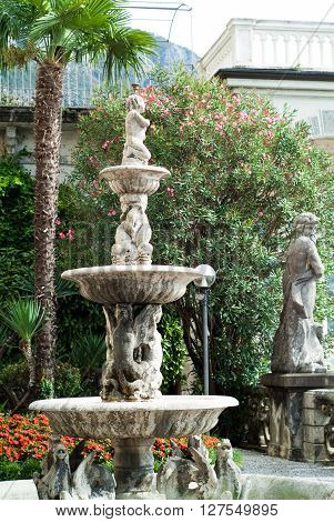 Varenna Italy - September 4th 2015: closeup of a fountain in the botanical garden at Villa Monastero in Varenna Italy.