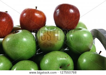 fresh red and green apples in vintage grey box ready to sell isolated on white background