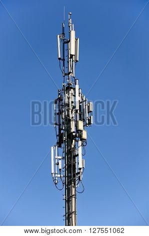 column of mobile communication against the background of the blue sky