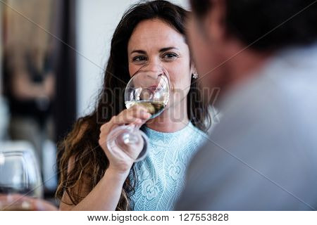 Close-up of woman drinking wine in a restaurant