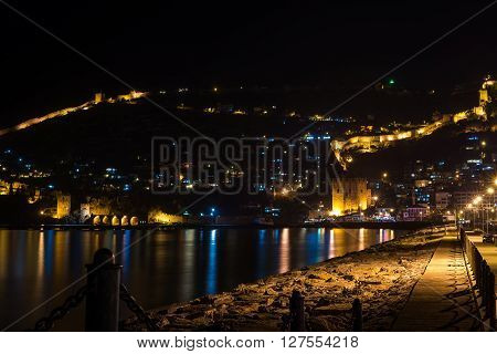 Night view of harbour, fortress and ancient shipyard in Alanya, Turkey