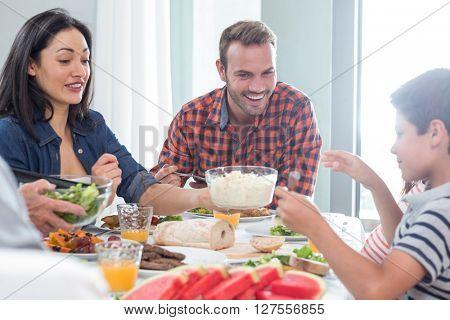 Happy family having breakfast in the morning
