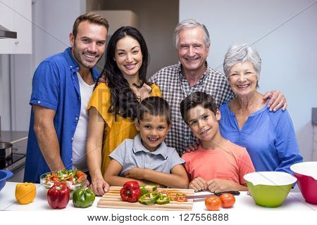 Portrait of happy family standing in the kitchen at home