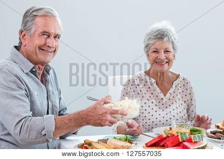 Elderly couple having breakfast in the morning