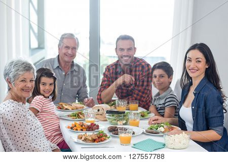 Portrait of happy family having breakfast in the morning