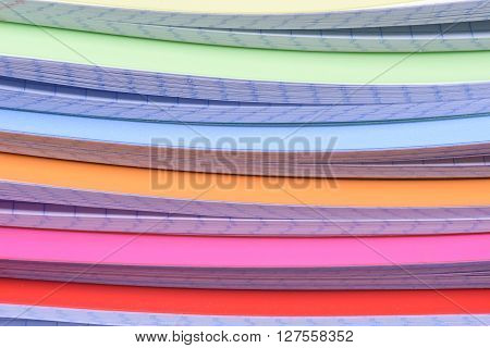 Stack of colorful exercise books as background