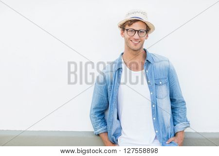 Portrait of happy young man smiling on terrace