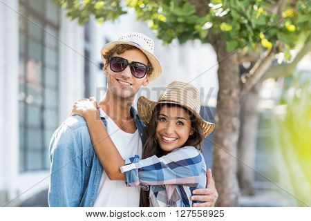 Portrait of happy young couple embracing each other