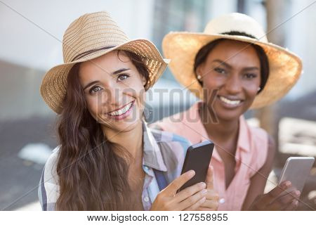 Portrait of young women using mobile phone